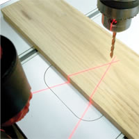 Two red laser beams cross at the exact location the drill bit is going to contact the stock