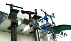 Image of wall mounted pipe clamp rack